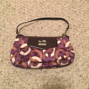 "Coach purple handbag with ""C"" logo"